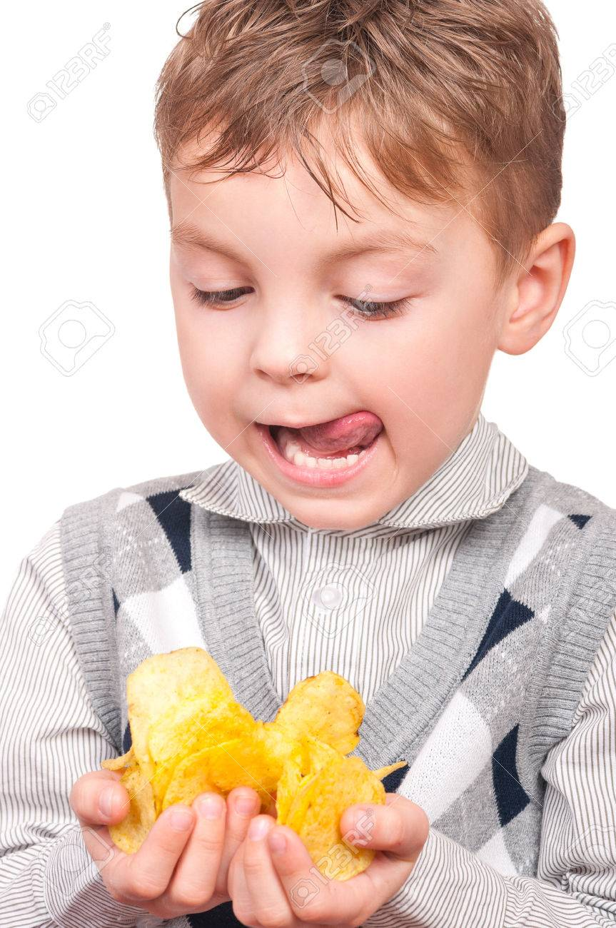 Portrait Of Cheerful Little Boy With Packet Of Potato Chips... Stock Photo,  Picture And Royalty Free Image. Image 72650924.