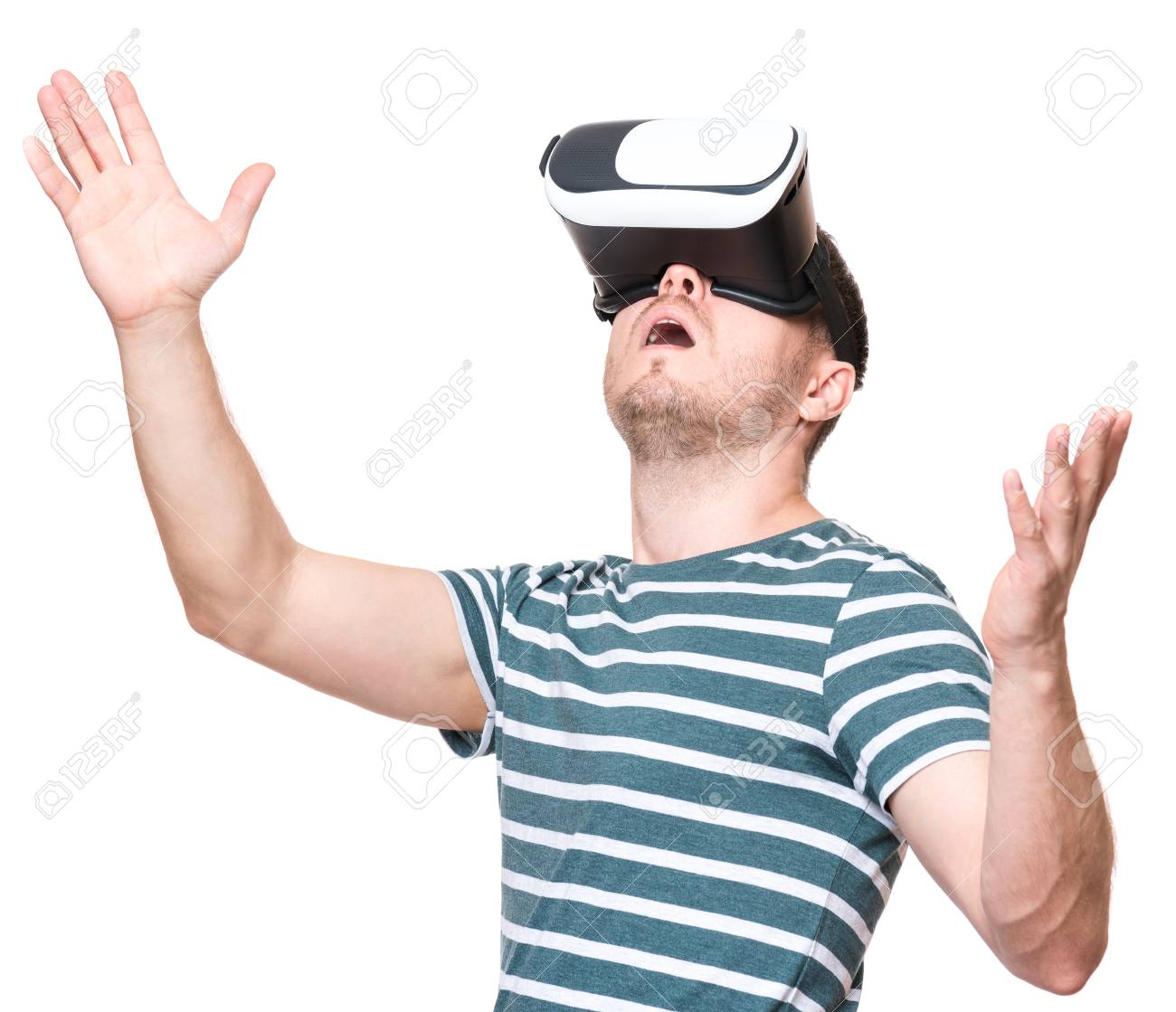 ef3f2817843 Amazed man wearing virtual reality goggles watching movies or playing video  games gesticulating hands