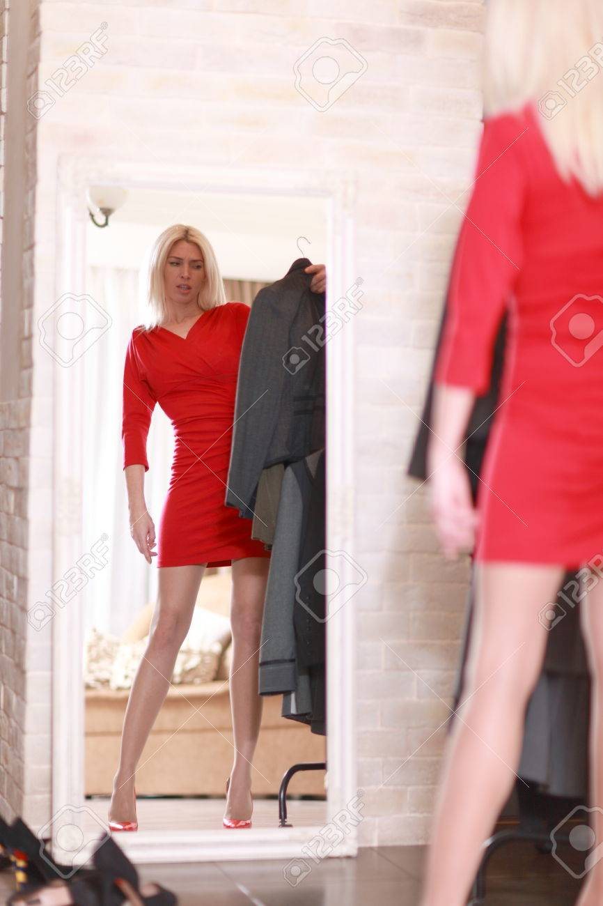 Woman Trying Red Dress Shopping For Clothing. Beautiful Happy ...