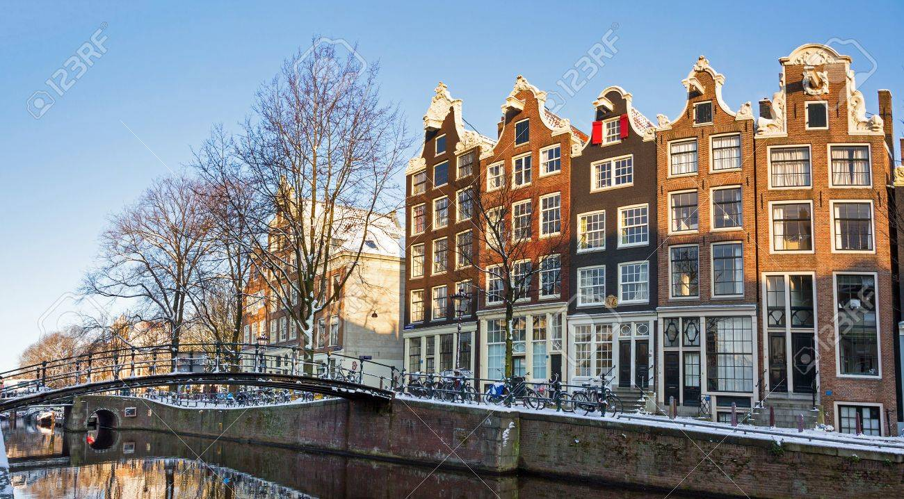 Beautiful early morning winter view on one of the Unesco world heritage city canals of Amsterdam, The Netherlands  Stock Photo - 19443150