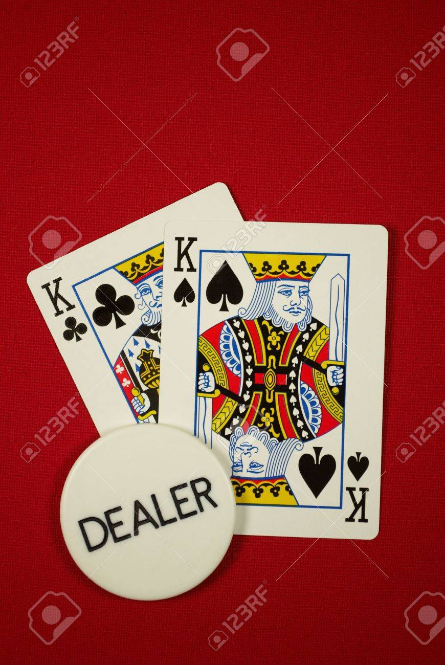 poker hand, pocket kings on the button, on red felt Stock Photo - 6161754