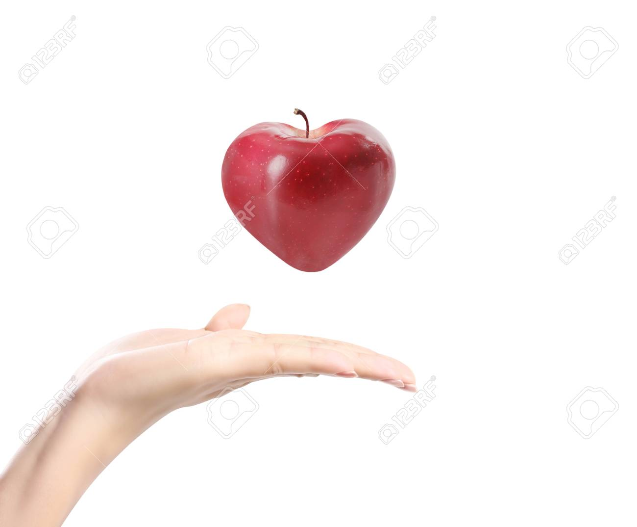 apple in a hand on white background Stock Photo - 15400784