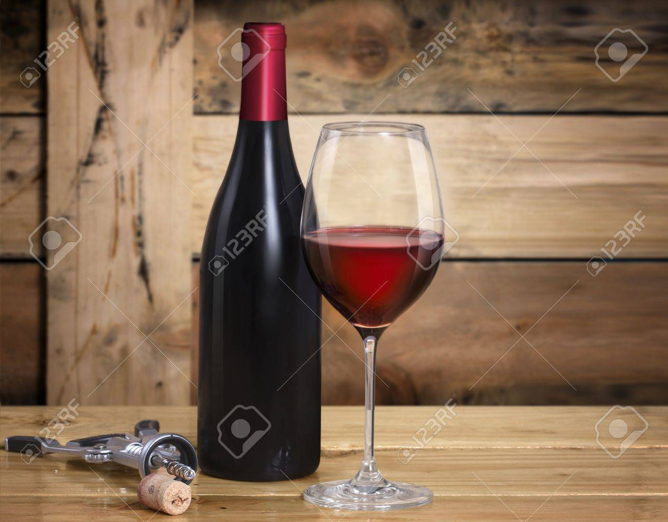 Wine glass and Bottle on wooden background Stock Photo - 16011111