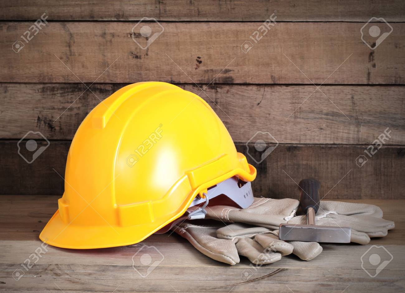Yellow hardhat and old leather gloves Stock Photo - 16542597