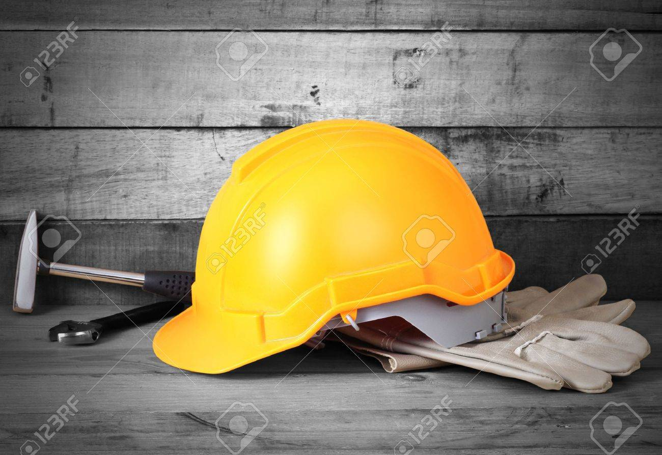 Yellow hardhat and old leather gloves Stock Photo - 17746696