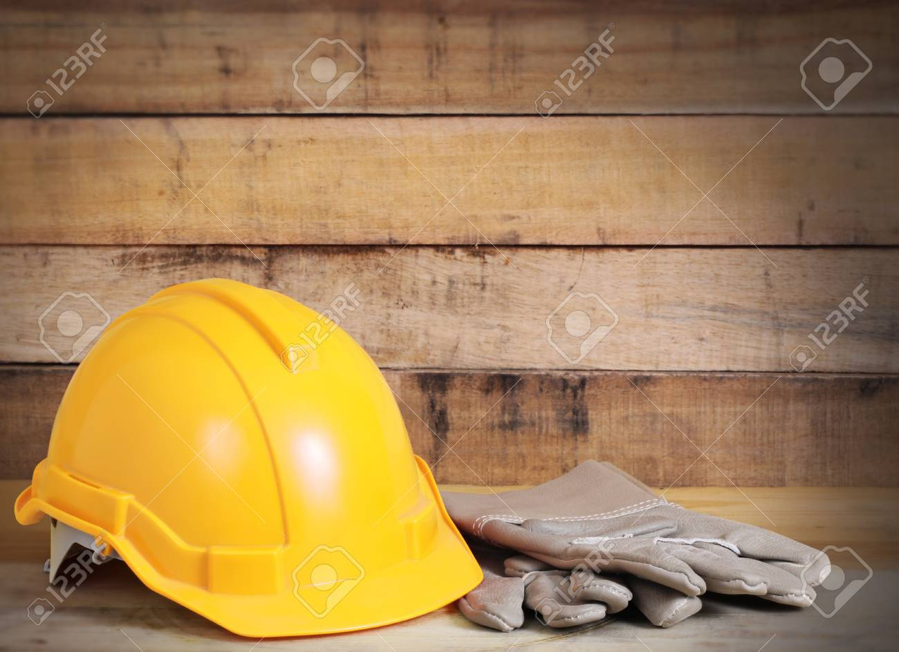 Yellow hardhat and old leather gloves Stock Photo - 17992872