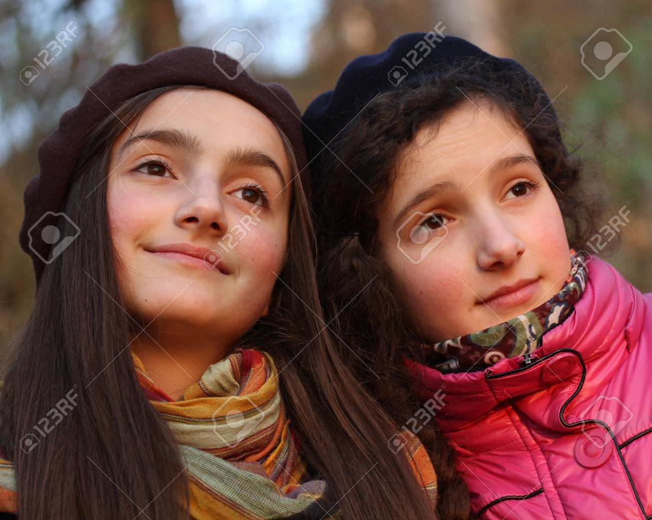 Portraits of two beautiful girls in the park. Stock Photo - 11474469