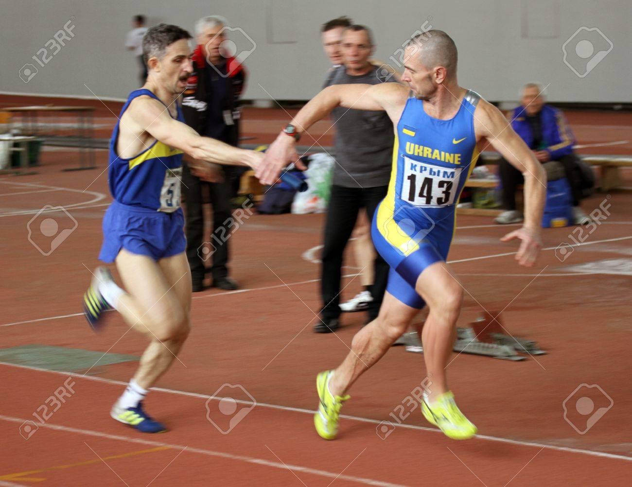 Unidentified men at the relay race on Ukrainian Veteran Track   Field Championships on March 03, 2012 in Kiev, Ukraine  Stock Photo - 12662751