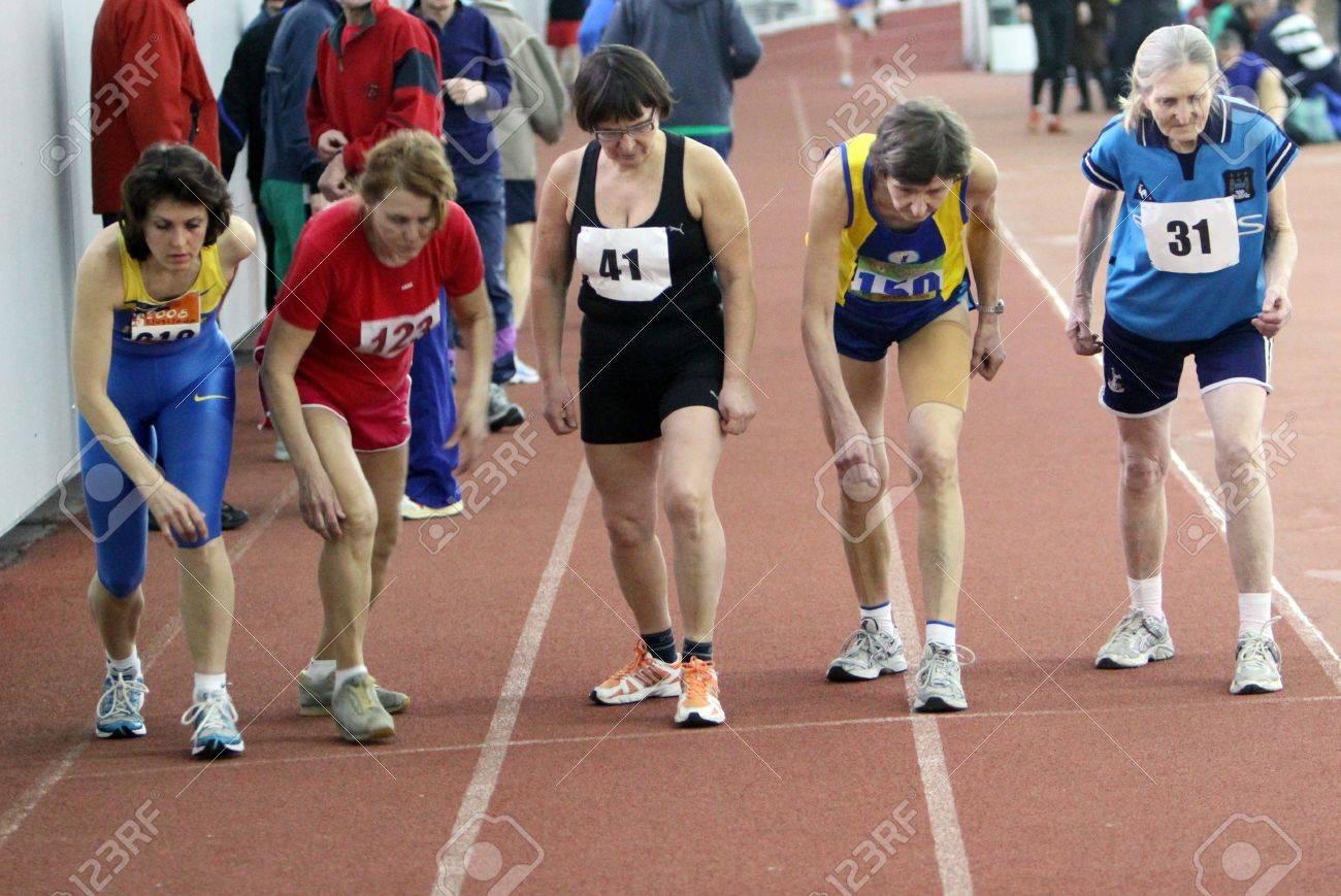 Unidentified women at the start of the 1500 meters race on Ukrainian Veteran Track   Field Championships on March 03, 2012 in Kiev, Ukraine  Stock Photo - 12662750