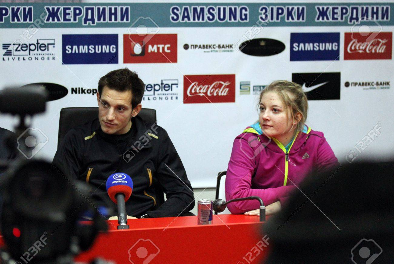 DONETSK, UKRAINE - FEB 11   L-R  Lavillenie Renaud and Shelekh Hanna on the press conference after Samsung Pole Vault Stars meeting on February 11, 2012 in Donetsk, Ukraine   Stock Photo - 12848703