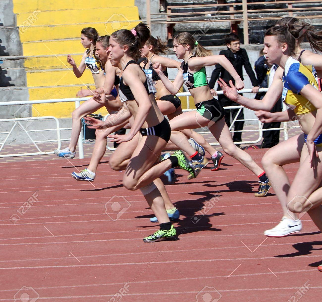 YALTA, UKRAINE - APRIL 25  Unidentified girls age 16-17 on the 100 meters race on Ukrainian Junior Track and Field Championships on April 25, 2012 in Yalta, Ukraine   Stock Photo - 13373062