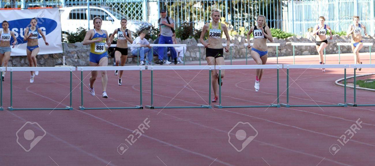 YALTA, UKRAINE - APRIL 26  Unidentified girls age 16-17 on the 400 meters hurdles race on Ukrainian Junior Track and Field Championships on April 26, 2012 in Yalta, Ukraine   Stock Photo - 13669326