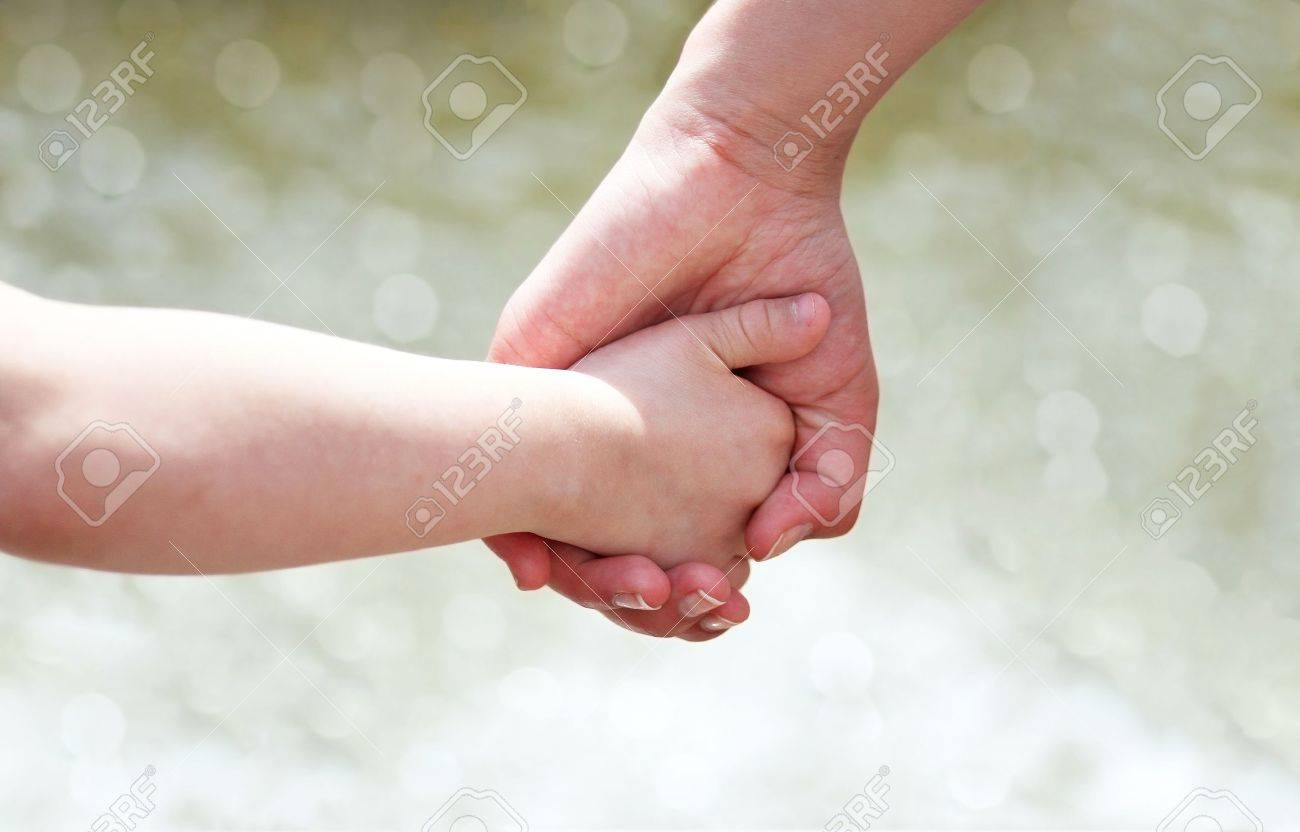 Hands of mother and child Stock Photo - 18152340
