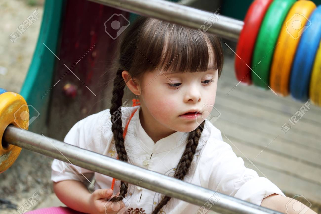 Portrait of beautiful young girl on the playground. Stock Photo - 24605194