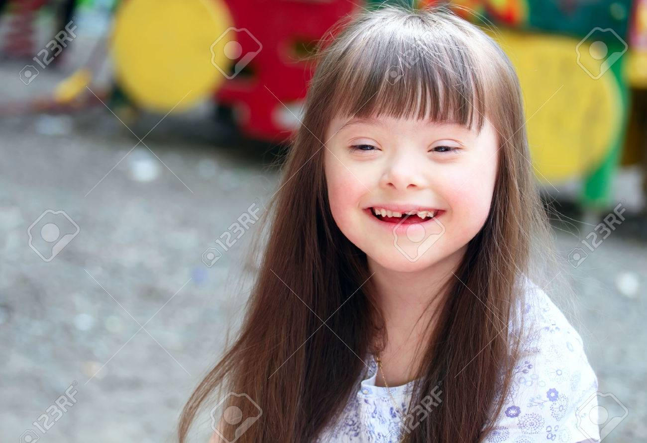 Portrait of beautiful young girl on the playground Standard-Bild - 25921737
