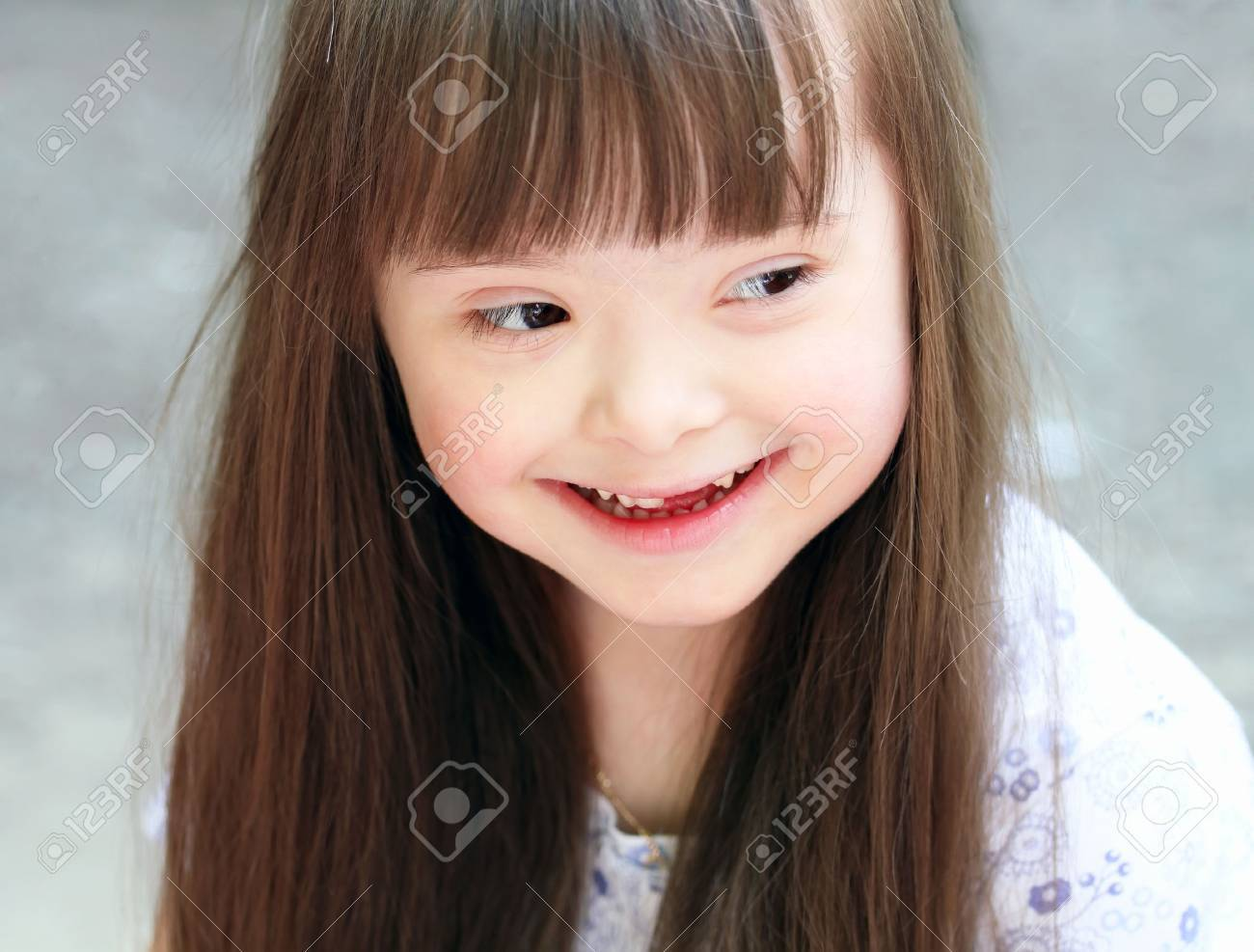 Portrait of beautiful young girl on the playground. Standard-Bild - 25903752