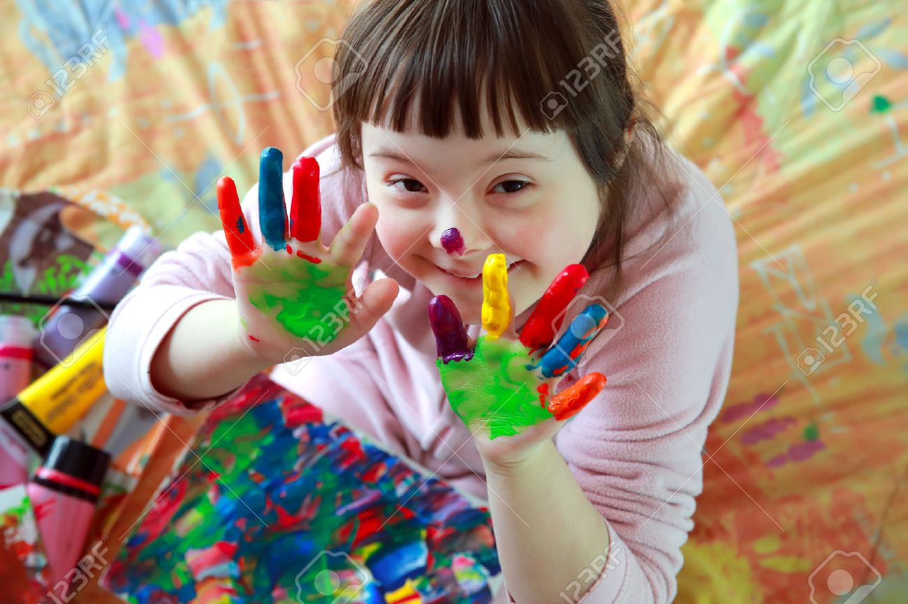 Cute little girl with painted hands Standard-Bild - 36953607