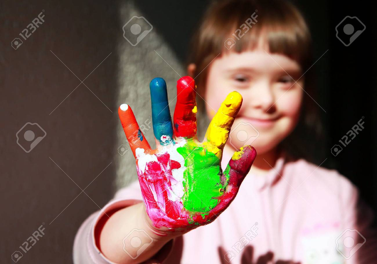 Cute little girl with painted hands Standard-Bild - 37086856