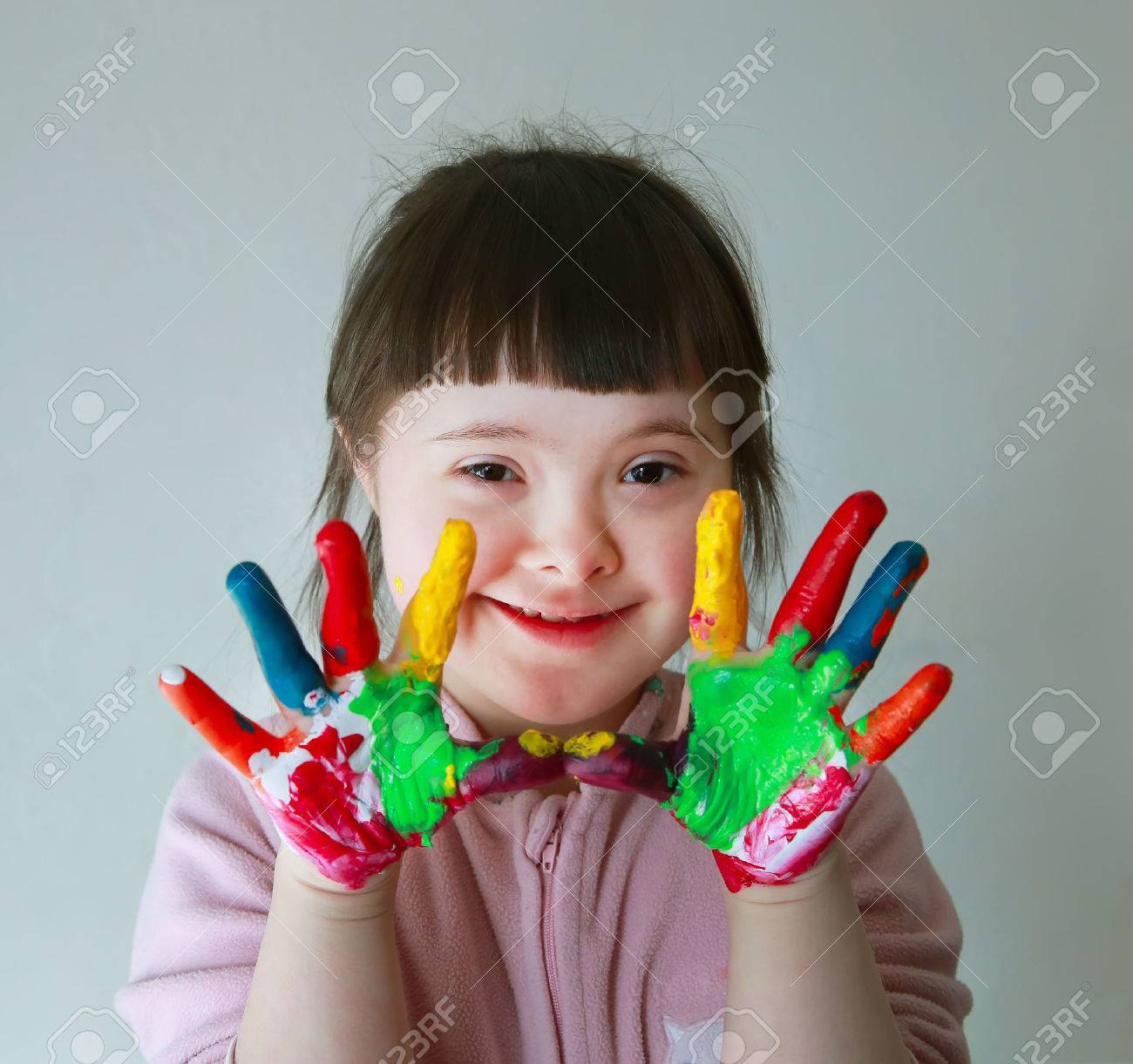 Cute little girl with painted hands. Isolated on grey background. Standard-Bild - 39267676