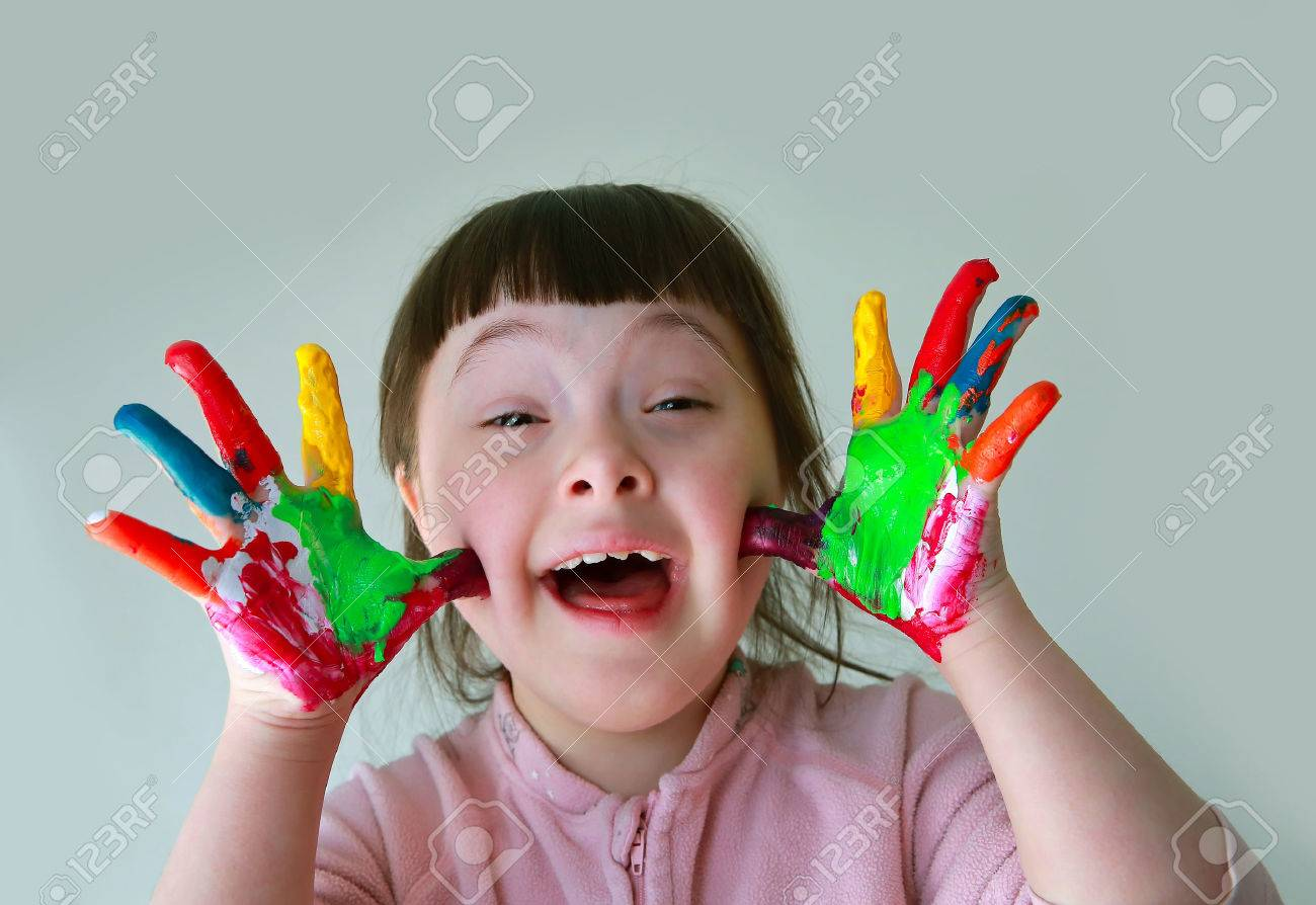 Cute little girl with painted hands. Isolated on grey background. Standard-Bild - 39593589
