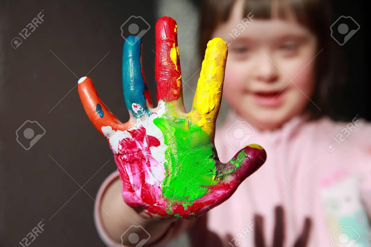 Cute little girl with painted hands Standard-Bild - 40375983