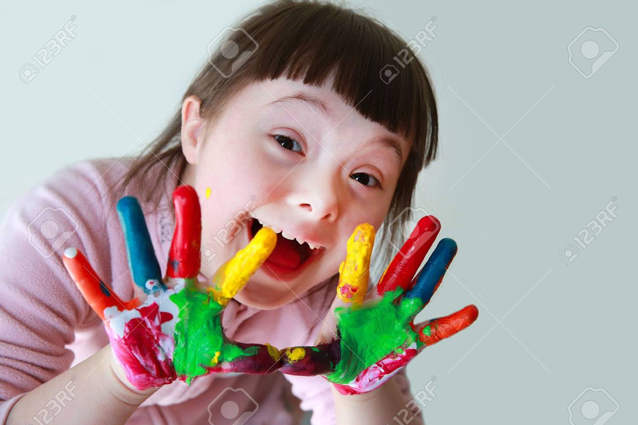 Cute little girl with painted hands. Isolated on grey background. Standard-Bild - 60903860