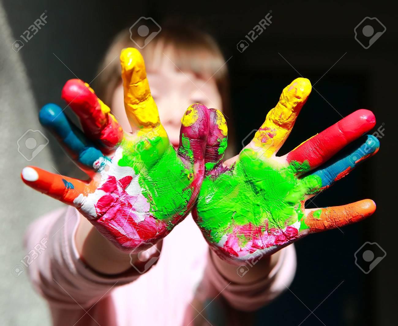 Cute little kid with painted hands Standard-Bild - 63018501