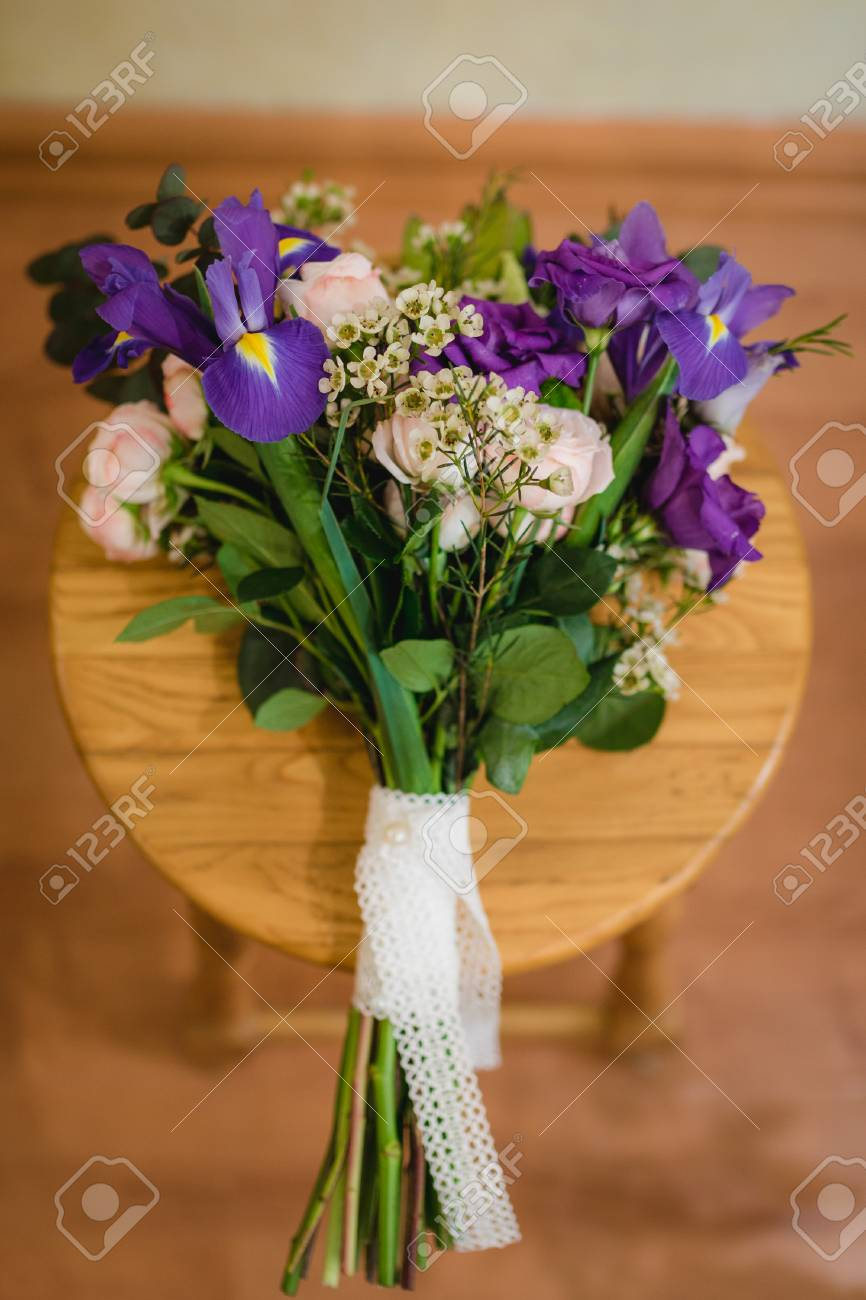 Bridal Bouquet Of Bride With Purple Flowers Lies On A Chair... Stock ...