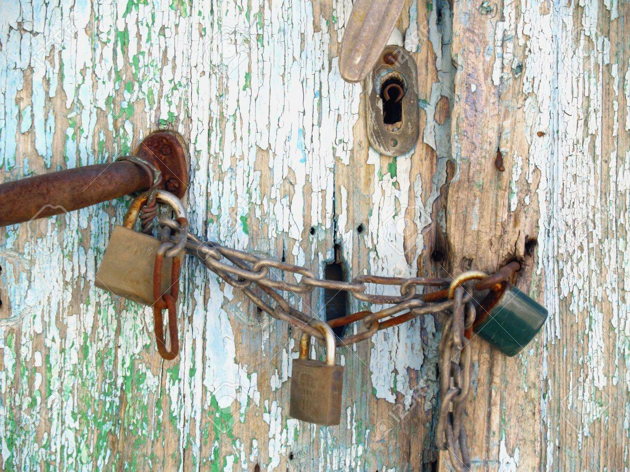 Stock Photo - detail of an old triple padlocked door in greece & Detail Of An Old Triple Padlocked Door In Greece Stock Photo ... Pezcame.Com