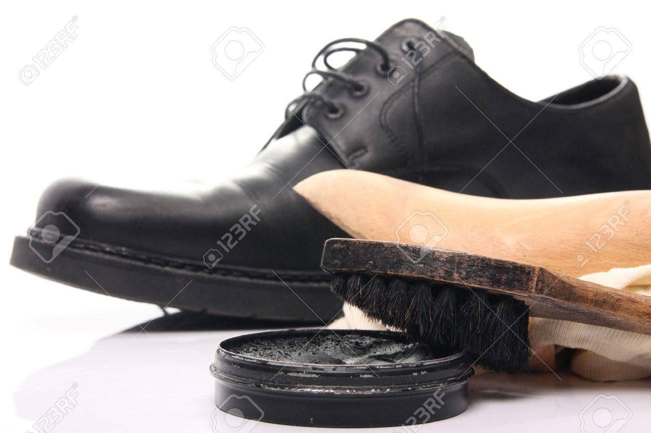 shoe care equipment and formal black shoe on white background Stock Photo - 6524865