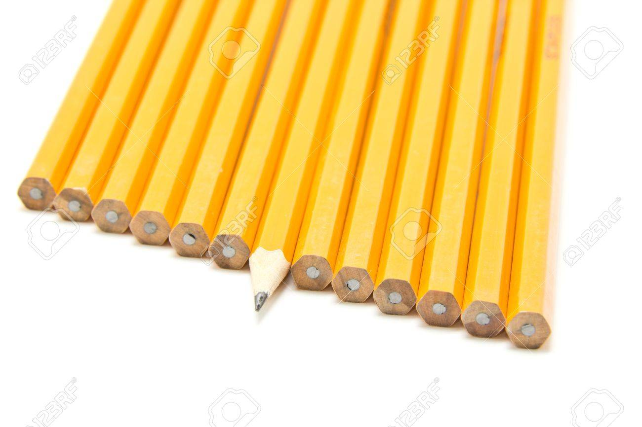 a sharp pencil sticking out form a croud of dull pencils stock photo