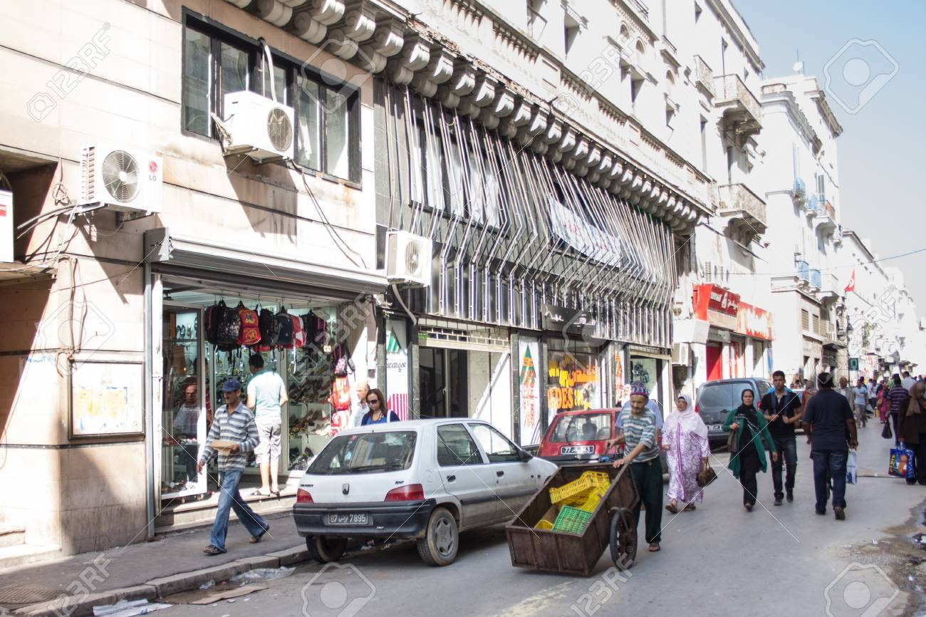 Local street market at the heart of the city of Tunis where the residents, come for great bargains for their day to day shopping Stock Photo - 17464932
