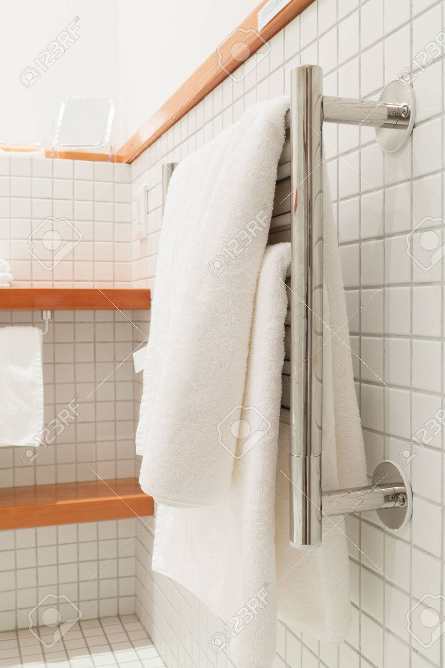 Two White Bath Towels Hanging On A Silver Towel Rack Stock Photo