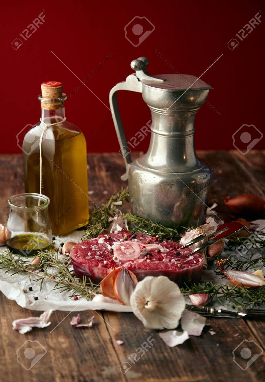Food: onions, romero, meat steak, salt, pepper, garlic, olive oil,fork, sauses - 49008554