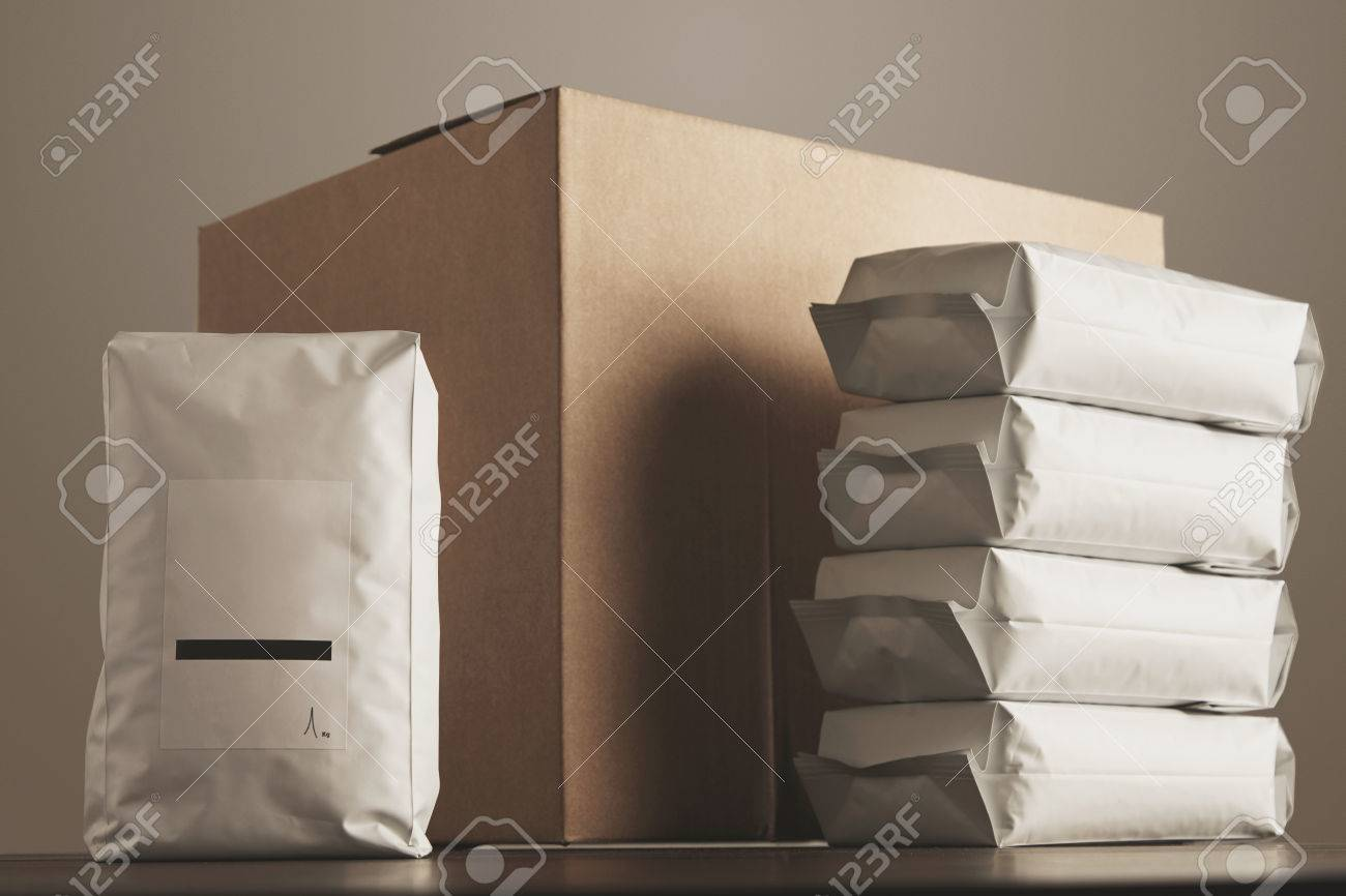 Big blank bulky sealed package with product presented in front of carton craft box and column of other packages. Ready for shipping, delivery and sale. Small business artisan concept. - 54077871