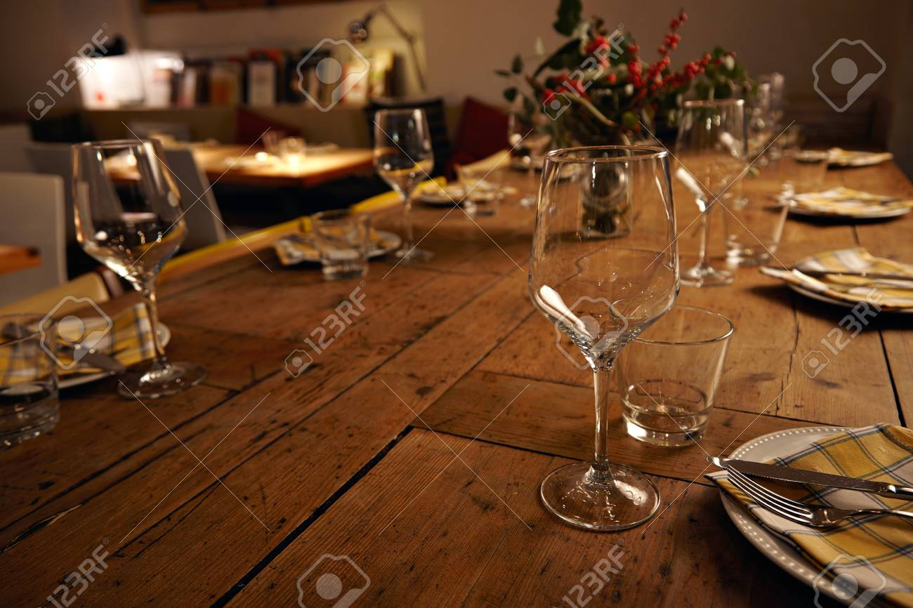 Stock Photo   View On Beautifully Decorated Dinner Table With Transparent  Wine Glasses, Table Napkins On Empty Dishes, Rustic Wooden Table And Big  Jar With ...