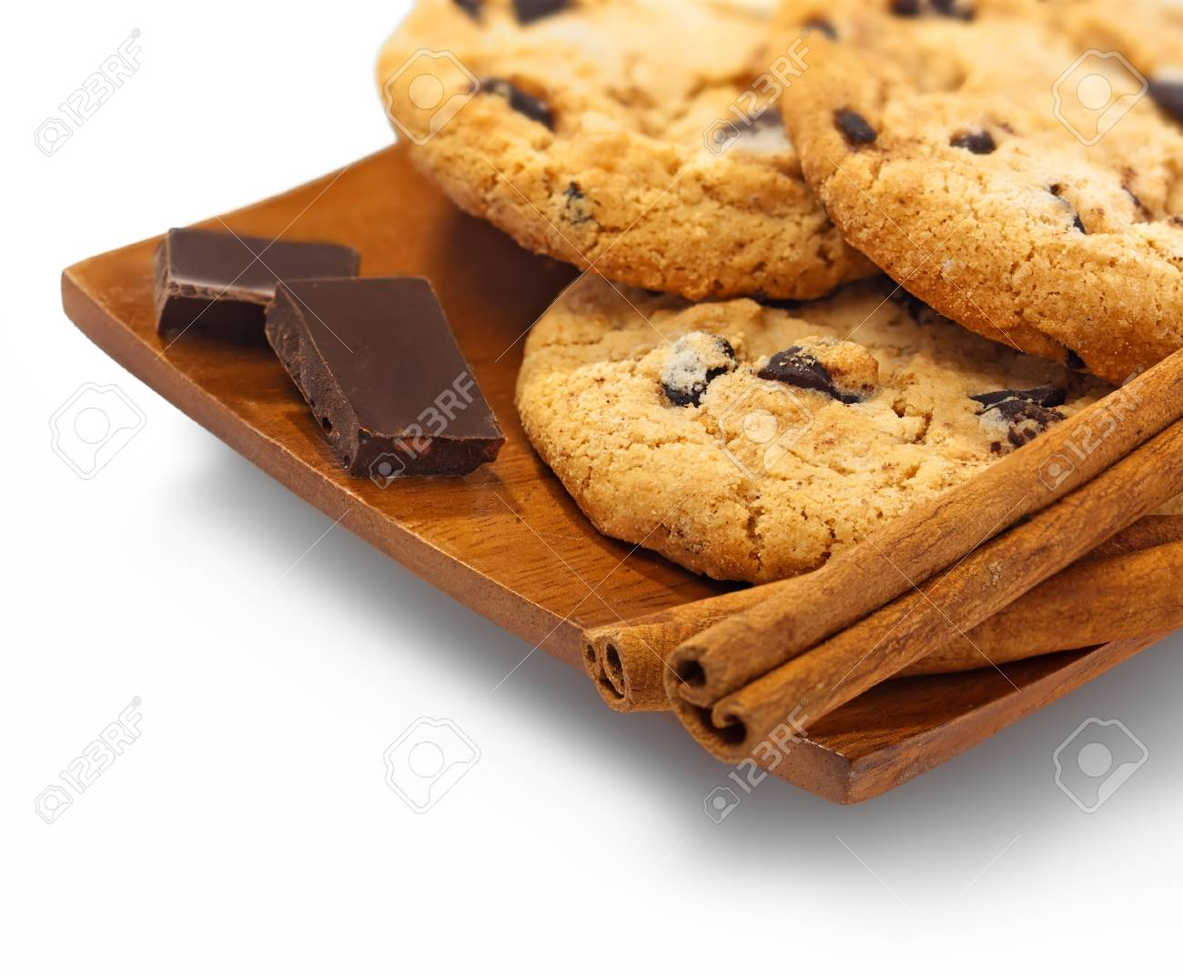 Cookies Chocolate And Cinnamon Sticks On The Wooden Plate