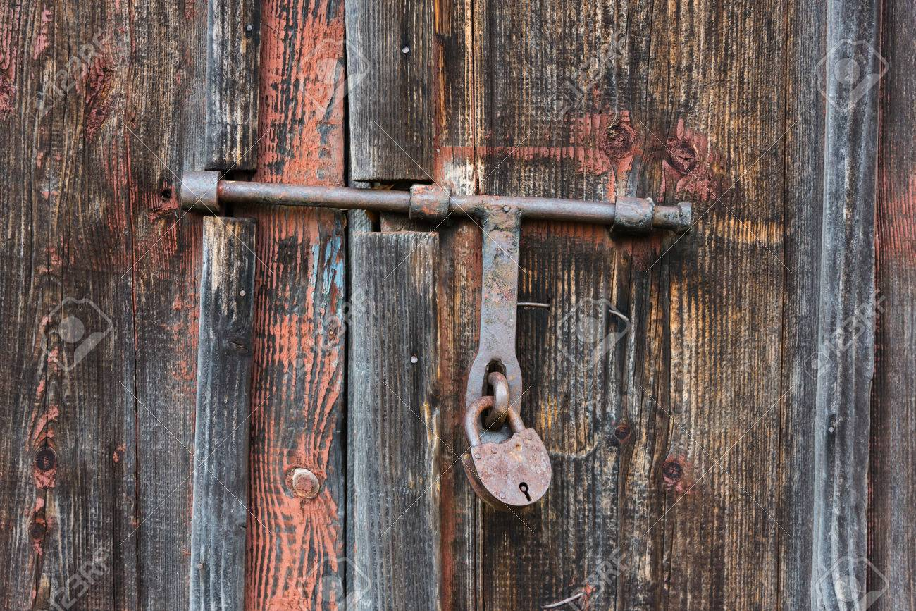 Stock Photo - The old door locked with a padlock hanging brackets. Set of backgrounds & The Old Door Locked With A Padlock Hanging Brackets. Set Of ...