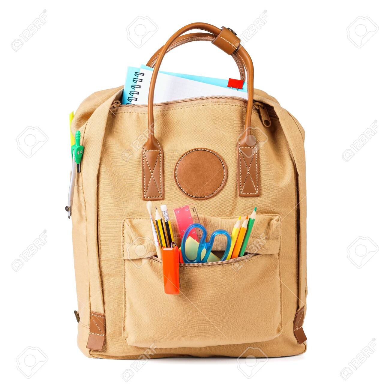 Brown school backpack full of various colorful stationery and supplies. Isolated on white background. - 126017881