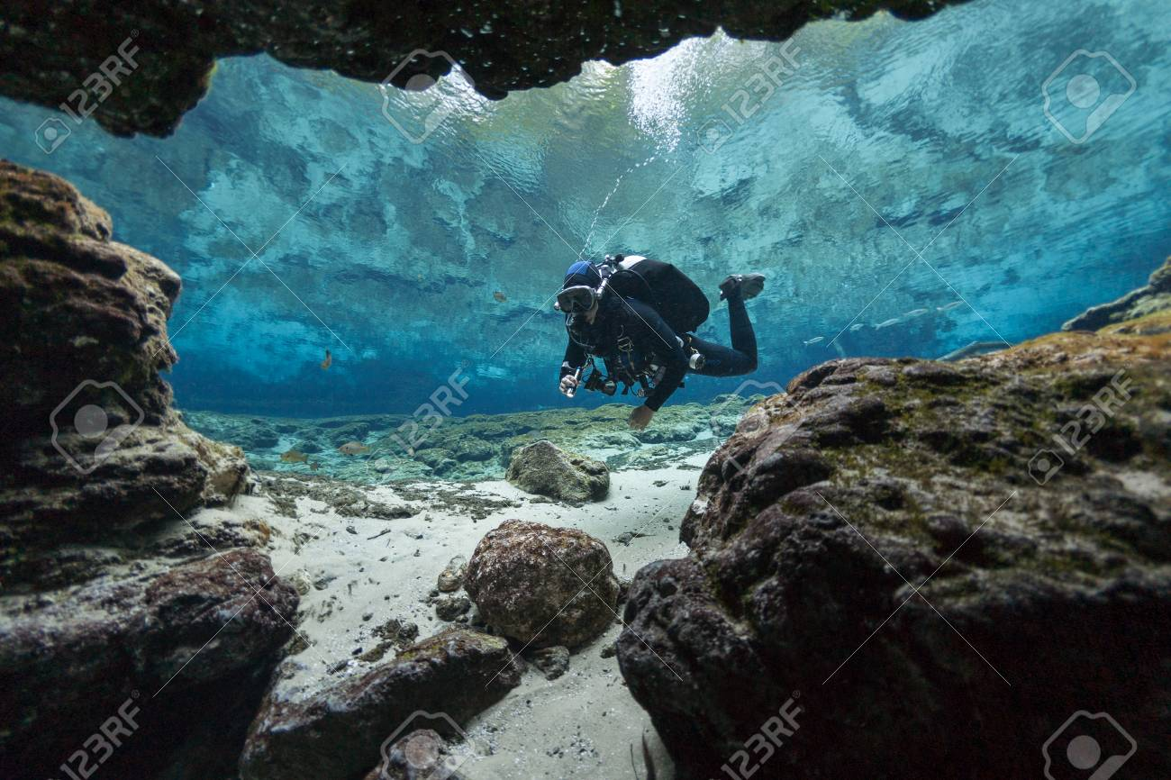 divers underwater caves diving Ginnie Springs Florida USA - 94803771