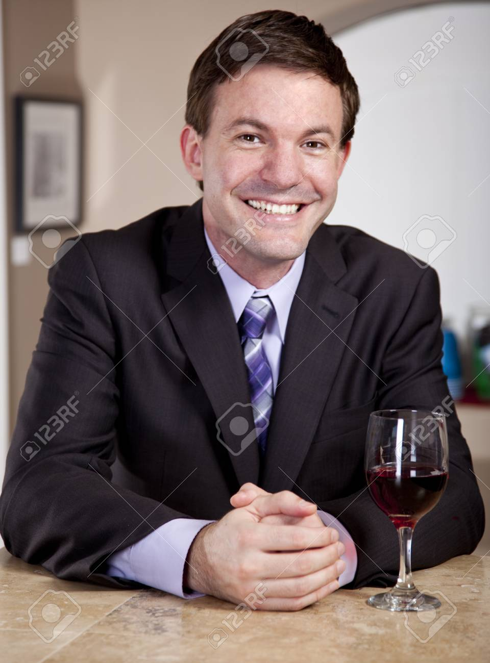 Man enjoying a Glass of Wine in a Bar Stock Photo - 16248377