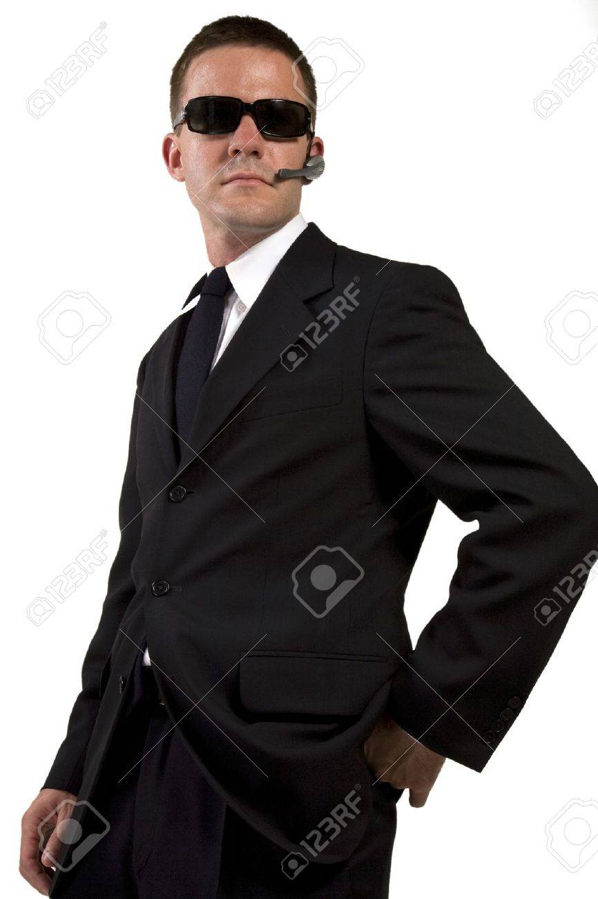 Secret Agent Reaches for Gun Stock Photo - 16638618