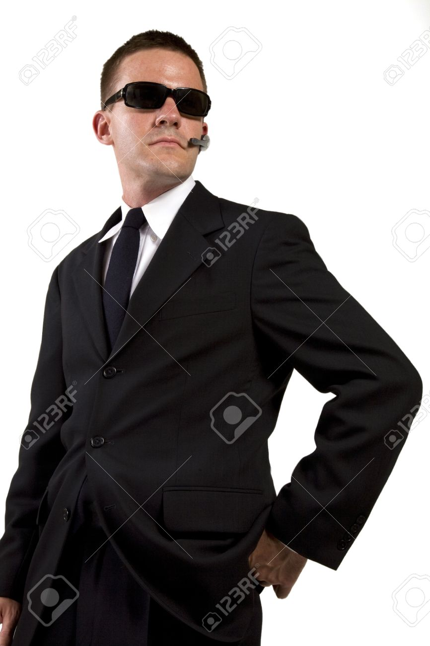 Secret Agent Reaches for Gun Stock Photo - 16638620