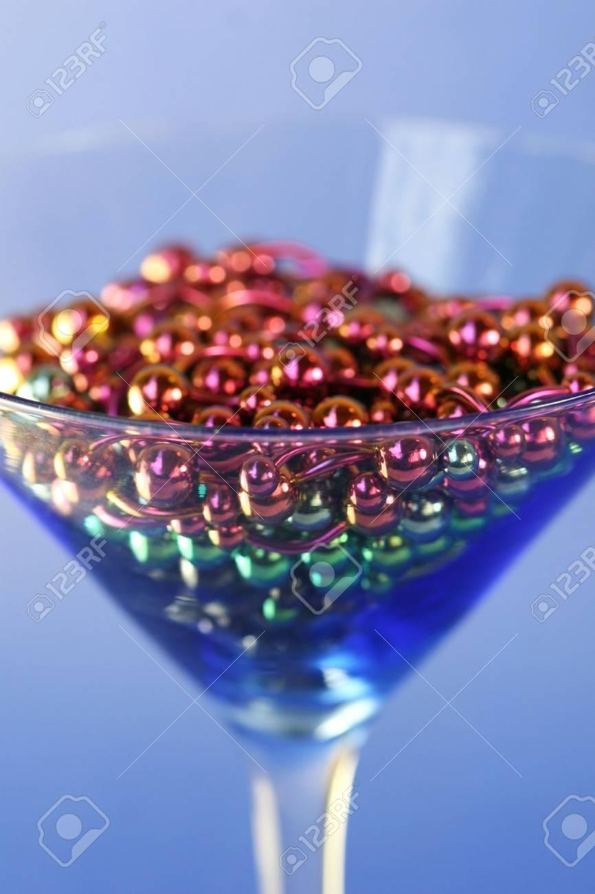 A martini glass full of titanium navel rings Stock Photo - 969000