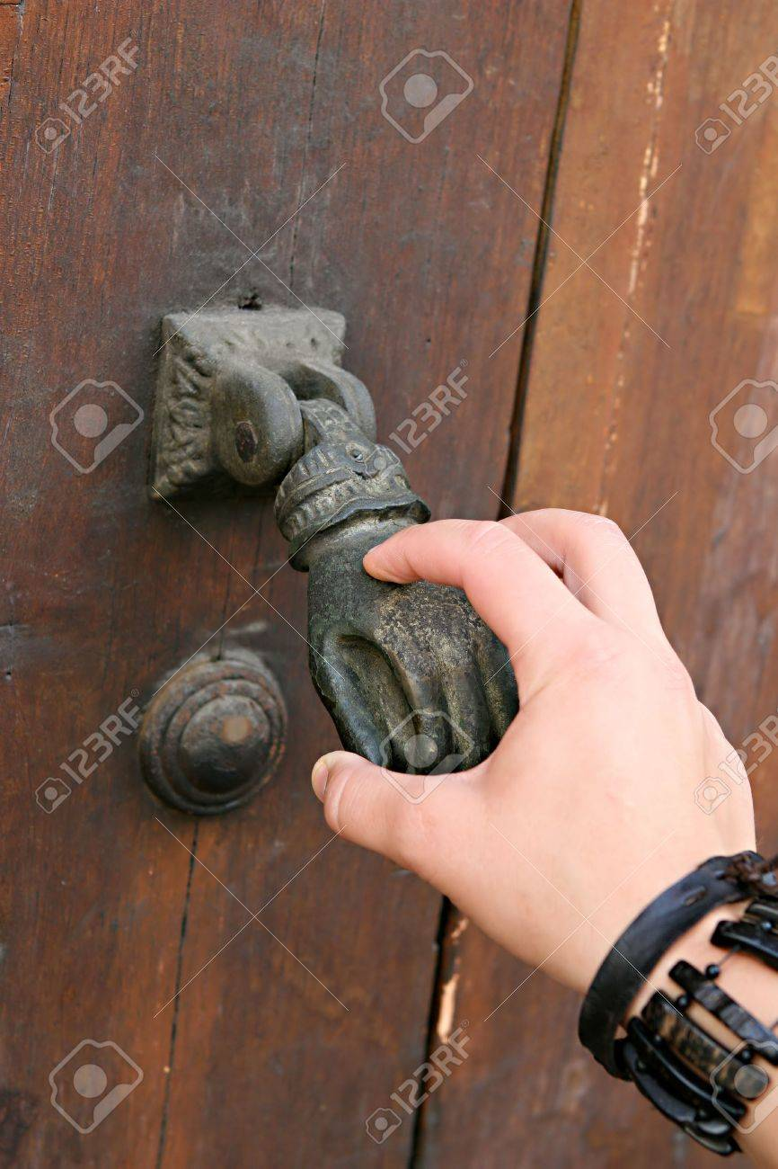 A Female Hand Knocks An Old Fashioned Hand Door Knocker Stock Photo    4514001