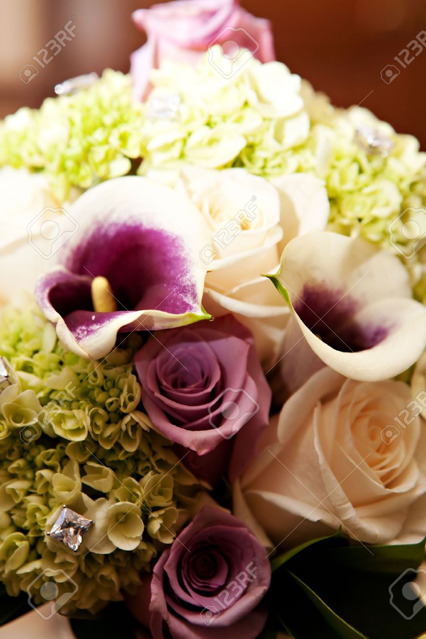A beautiful flower arrangement with roses calla lilies and diamonds a beautiful flower arrangement with roses calla lilies and diamonds stock photo 8200188 izmirmasajfo Images