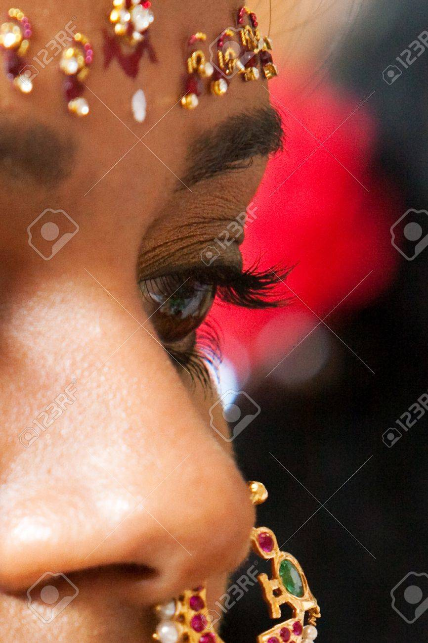 A Closeup Of The Face And Nose Ring Of A Young Indian Brde Stock