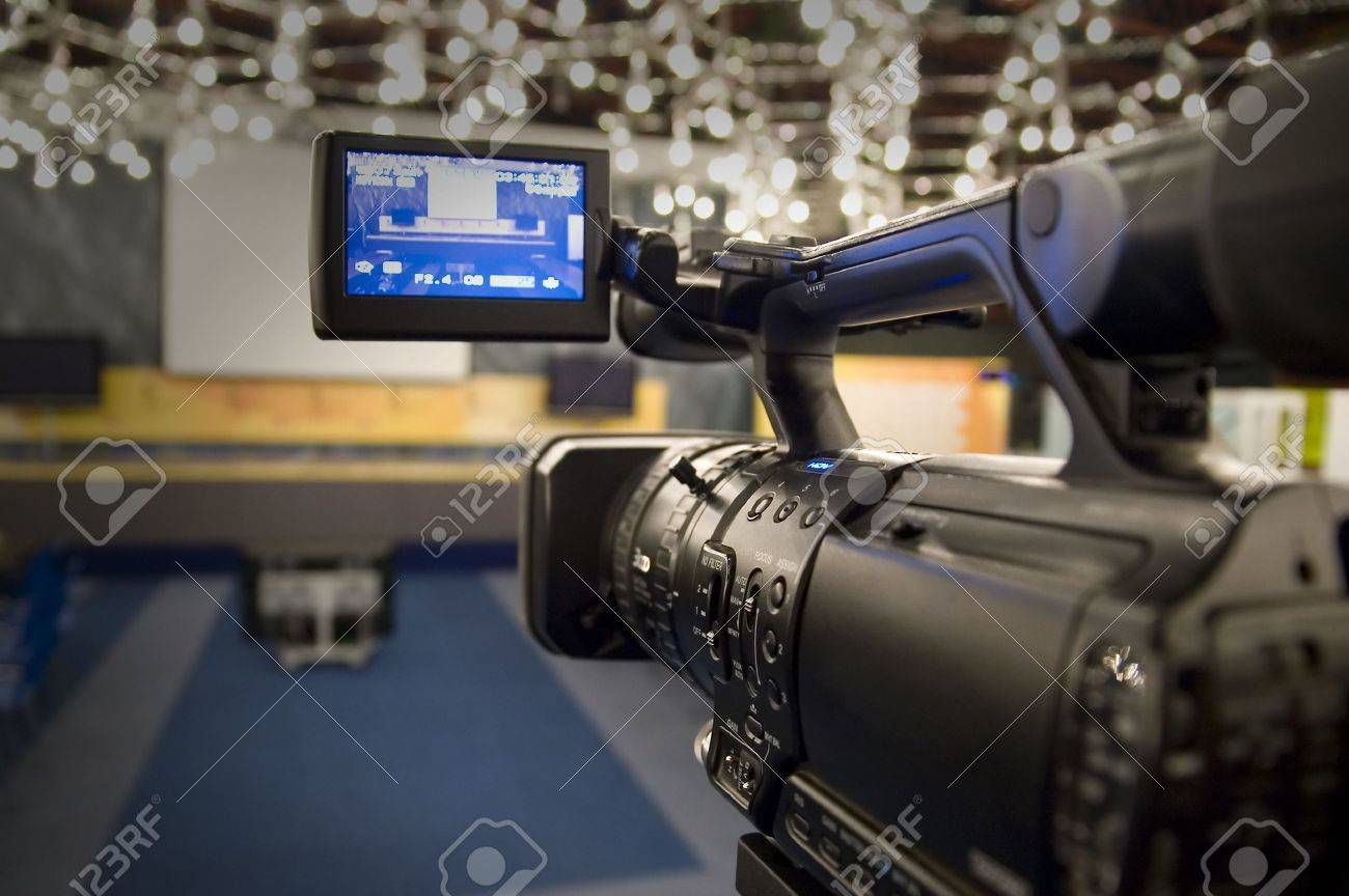Digital video camera shoots meeting Stock Photo - 2131227