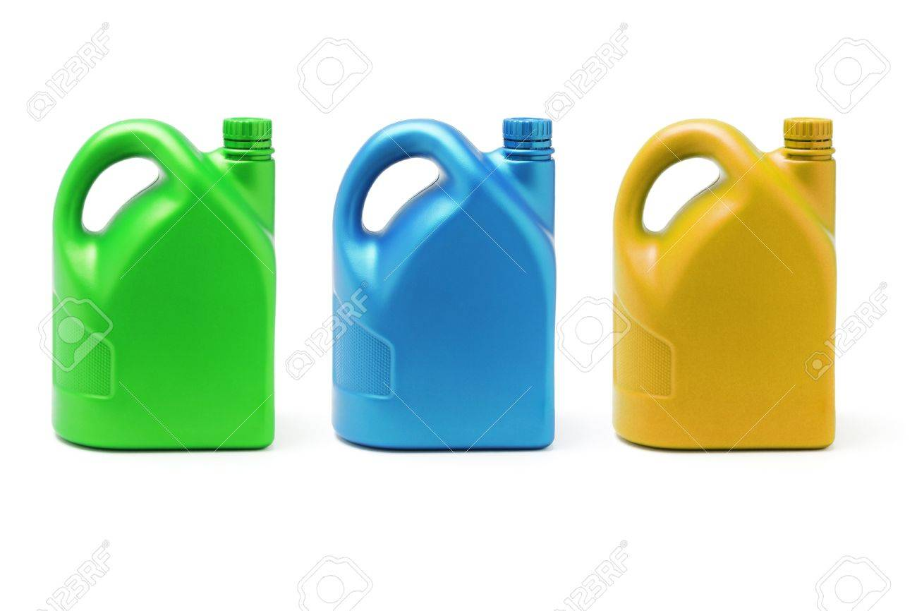 Three color containers of lubricant on white background Stock Photo - 9766696