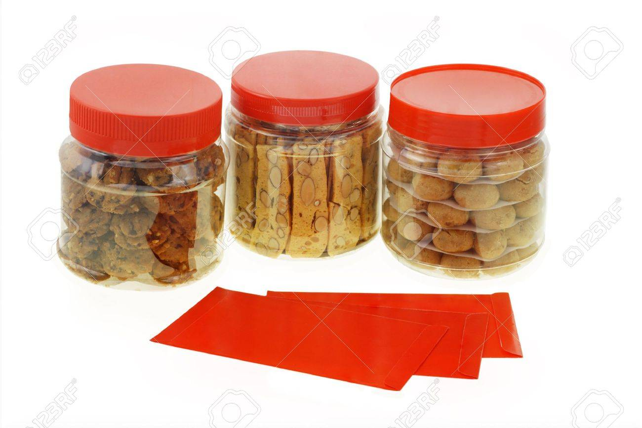 Chinese New Year red packets and cookies in plastic containers Stock Photo - 9768425